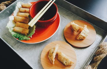 fried-spring-rolls-and-dumplings-on-top-of-tray-218769